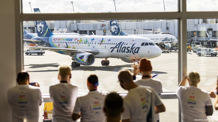 Guests line up to see the Alaska pride plane
