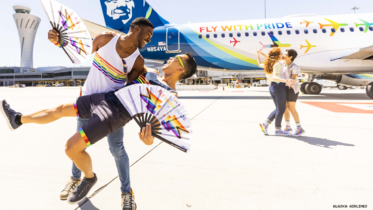 Teraj and Barry dip in front of Alaska Airlines Pride plane