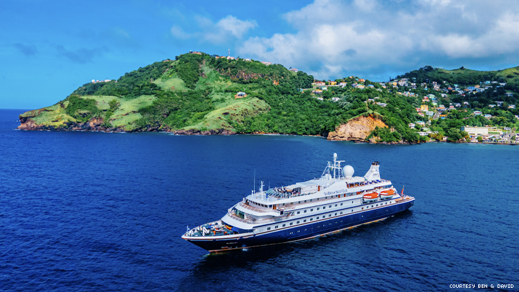 SeaDream Yacht in Front of a Caribbean island
