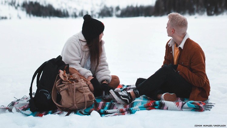 Photo of Couple Picnicing in Snow