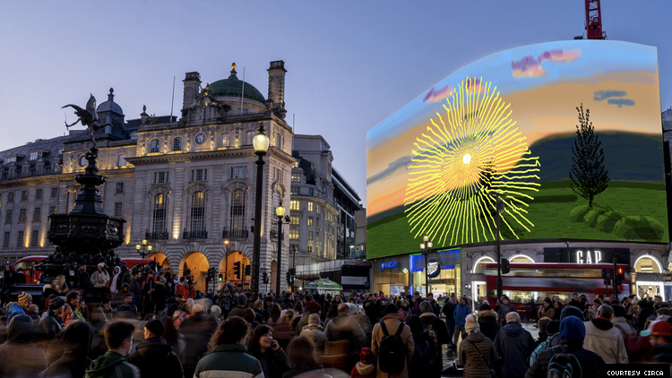 David Hockney's artwork Don't Stare at The Sun... on a big screen in London's Picadilly Circus