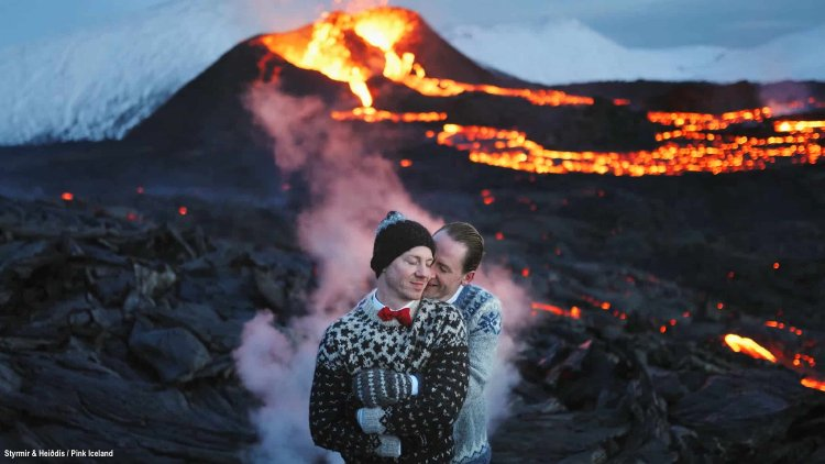 Gay couple wedding in front of Iceland volcano