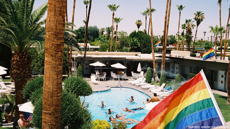 INNdulge pool with rainbow flag gay hotel in Palm Springs