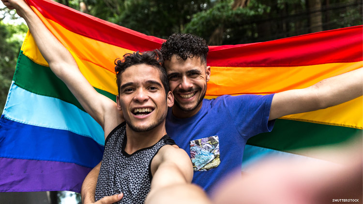 Queer couple with a rainbow flag