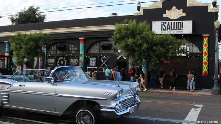 A lowrider in front of Salud! in San Diego's Barrio Logan