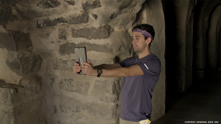 James of 32nd The Amazing Race in a tomb in india