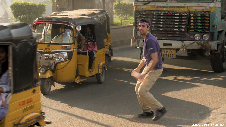 James in a busy street in India on The Amazing Race