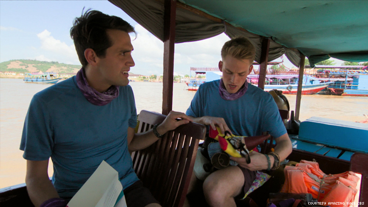 Will and James of 32nd The Amazing Race on a boat with the Roaming Gnome