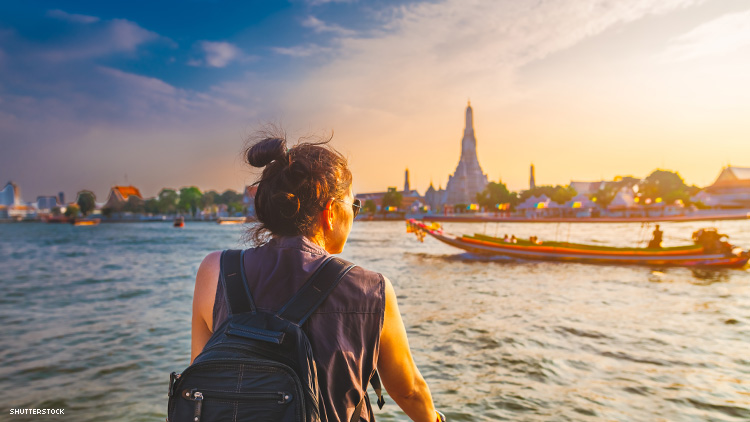 woman on a small boat in thailand at sunset