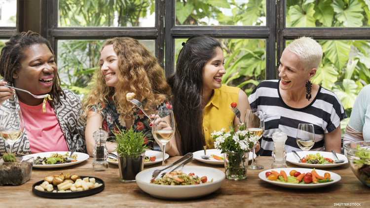 Diverse group of women eating at a restaurant