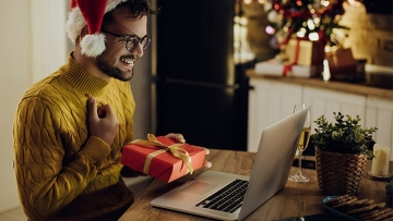 Opening present in front of computer