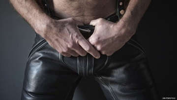 close up on a bare chested white man in leather