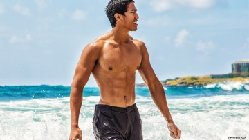 Asian man on Hawaiian beach
