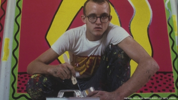 The queer artist Keith Haring painting