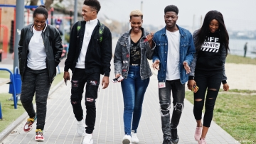 Young Black friends walk together