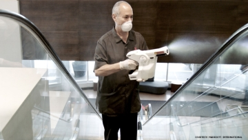 A worker at Marriott uses an electrostatic cleaner