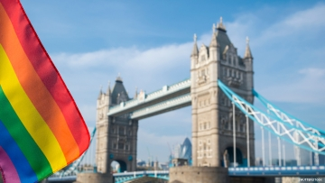Rainbow flag flies in front of London's iconic bridge and skyline