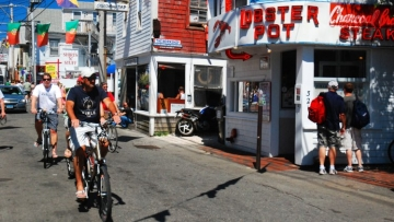 P-town commercial street with two male bike riders