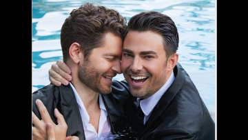 jonathan bennett and jaymes vaughn in a pool in suits hugging
