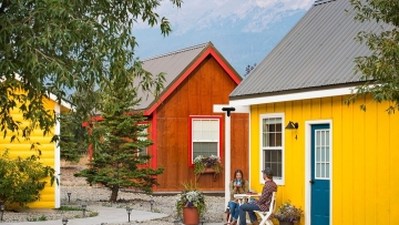 Stay in these Eco-Friendly Tiny Homes at the Tiny Home Village at St. Mary Village just outside the eastern entrance to Glacier National Park