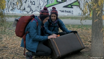 Will and James of 32nd The Amazing Race by the Berlin Wall