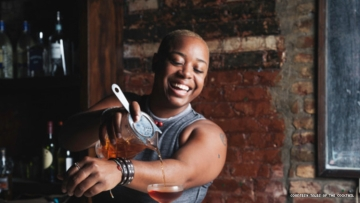 Black mixologist Tiffanie Barriere pours a cocktail