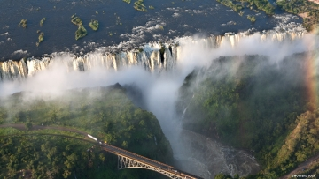 Victoria Falls seen from above with road bridge