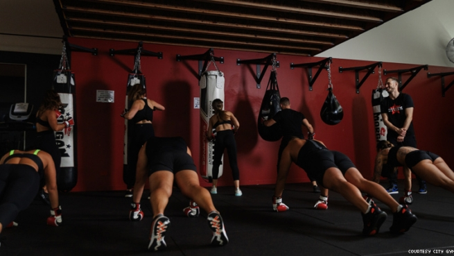 Group doing boxing bag work out