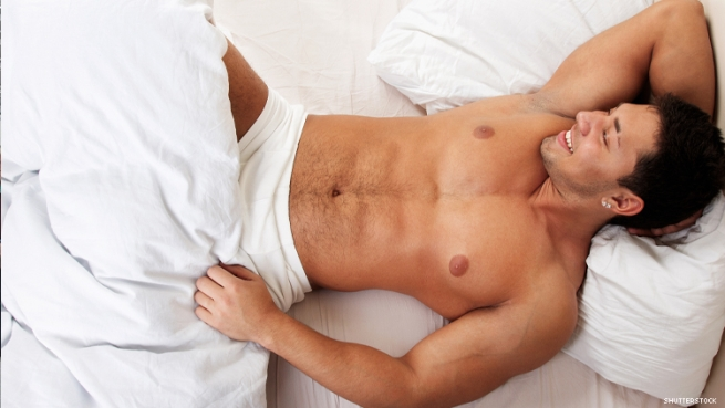 A man in bed wearing nothing but underwear