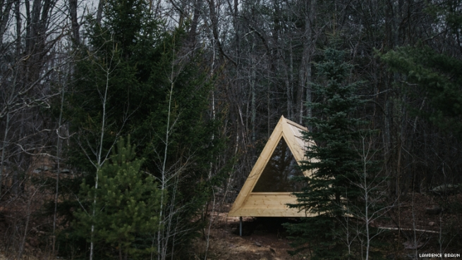 An A-frame cabin in the woods