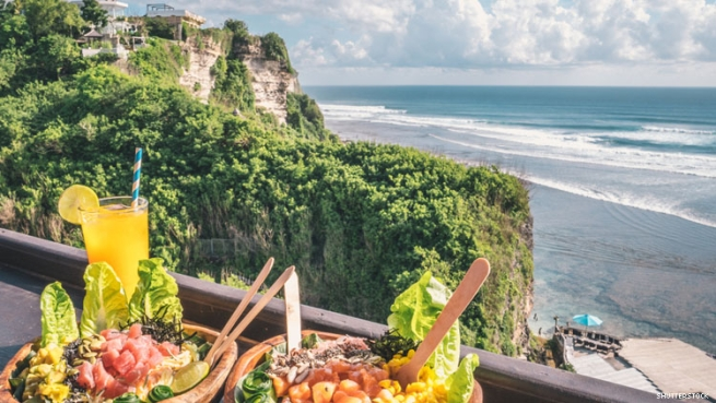 Healthy salads pictured above a cliffside beach