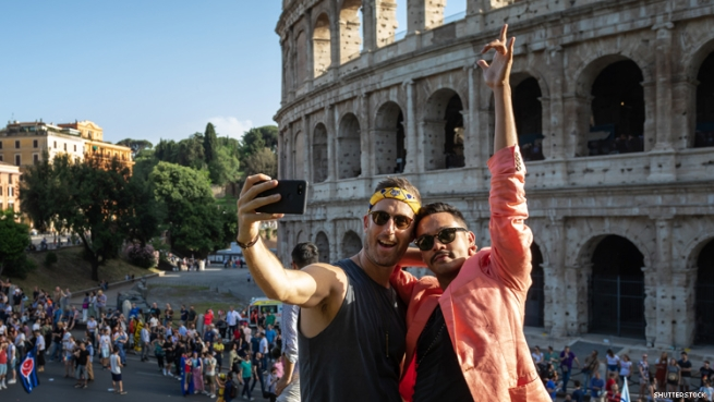 Gay couple in front of Coliseum Rome