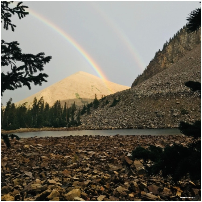 A double rainbow over Baker Lake in Great Basin National Park