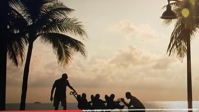 Greater Together ad image featuring two dads with triplets on a Ft Lauderdale beach