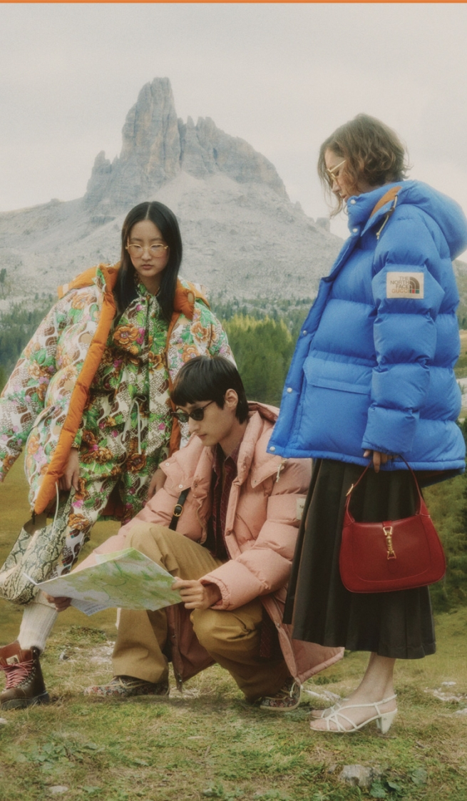 Three people wearing North Face x Gucci in wilderness
