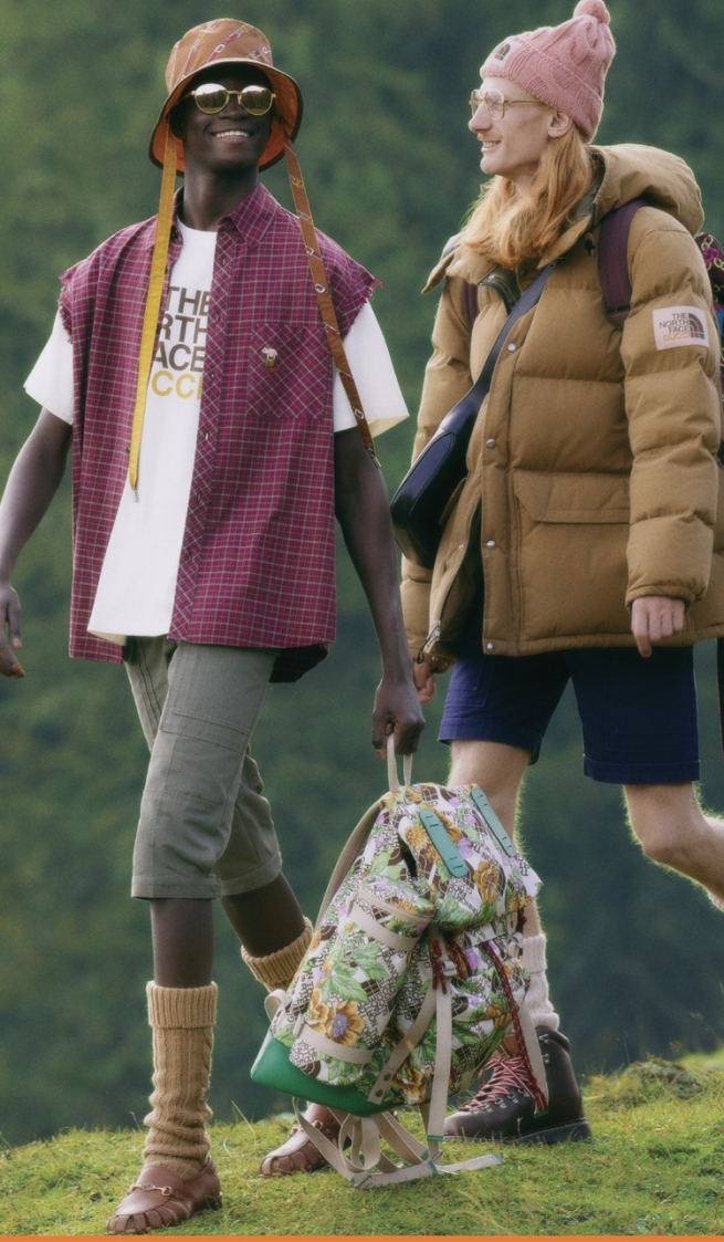 two men, one Black hike in North Face x Gucci outfits