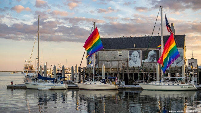 Provincetown harbor with boats and rainbow flags
