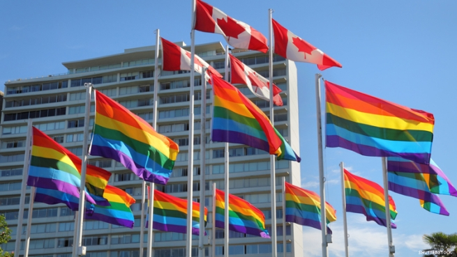 Rainbow flags fly with Canadian flag in Vancouver