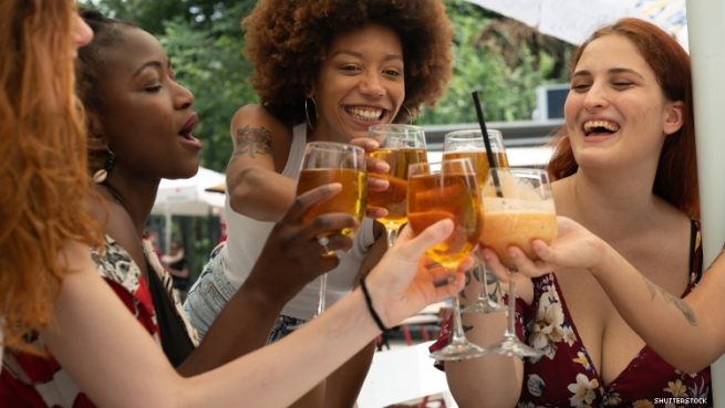 Women cheering with drink glasses
