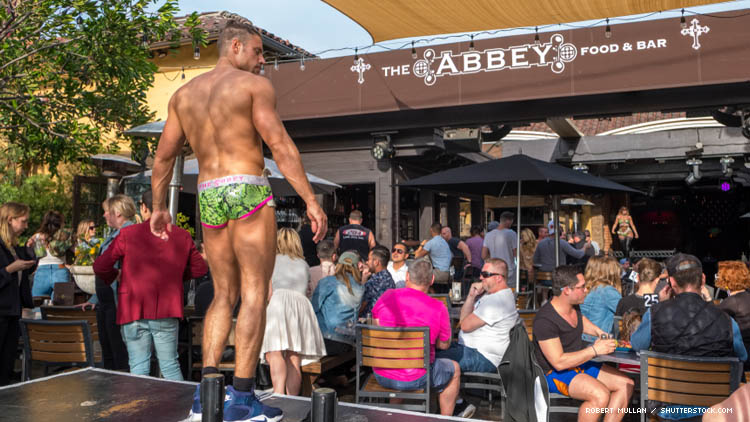 A go-go dancer in front of The Abbey bar in Los Angeles in 2018