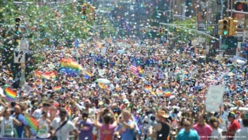 Photo of 2019 World Pride, with thousands of LGBTQ people in a NYC street