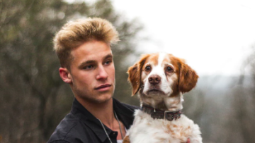 hot guy with a dog